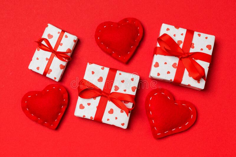 Top view of colorful valentine background made of gift boxes and red textile hearts. Valentine`s Day concept.  royalty free stock photography