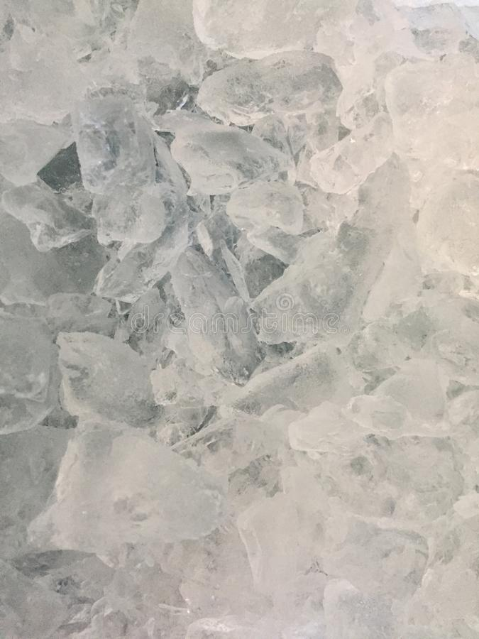 Top view of commercially made ice chips. Ice chips commercially made for keeping things cold. Multi shaped. Looking down at the ice shapes stock images