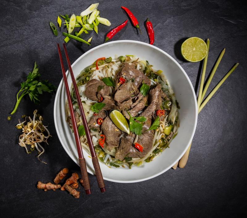 Top view composition of Pho bo soup royalty free stock photography