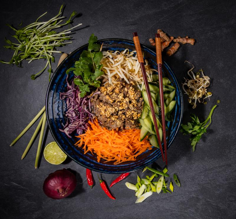 Top view composition of vietnamese food in bowl. Top view composition of Bun bo nam bo vietnamese food in bowl stock photos