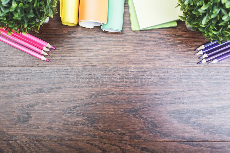 Contemporary desktop with colorful supplies. Top view of contemporary wooden royal oak office desktop with colorful supplies and copy space. Work place and art stock photo
