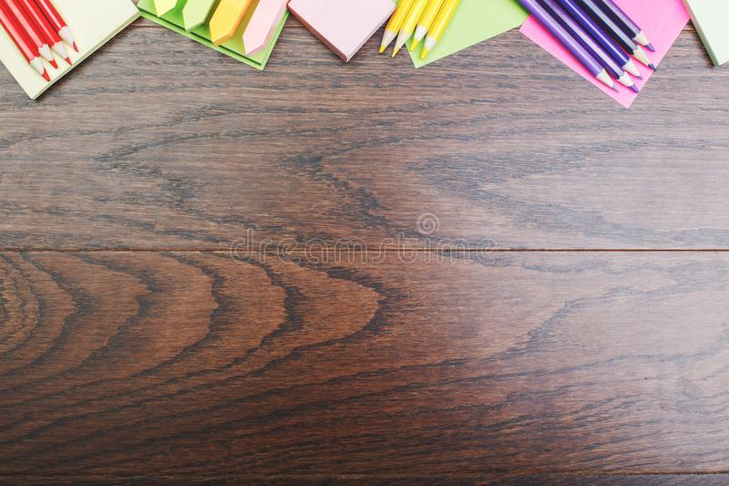 Contemporary tabletop with colorful supplies. Top view of contemporary wooden royal oak office tabletop with colorful supplies and copy space. Work place and art royalty free stock images