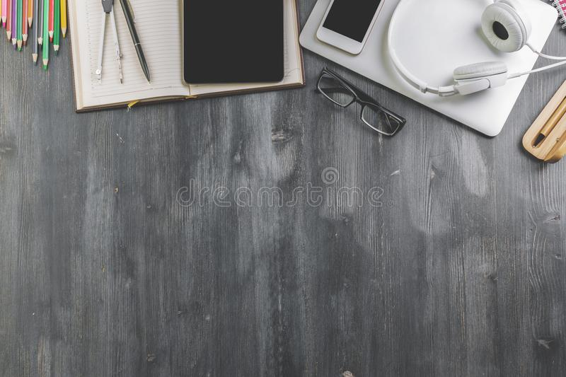 Contemporary tabletop with copyspace. Top view of contemporary wooden tabletop with copy space and various items. Work place and style concept royalty free stock photo