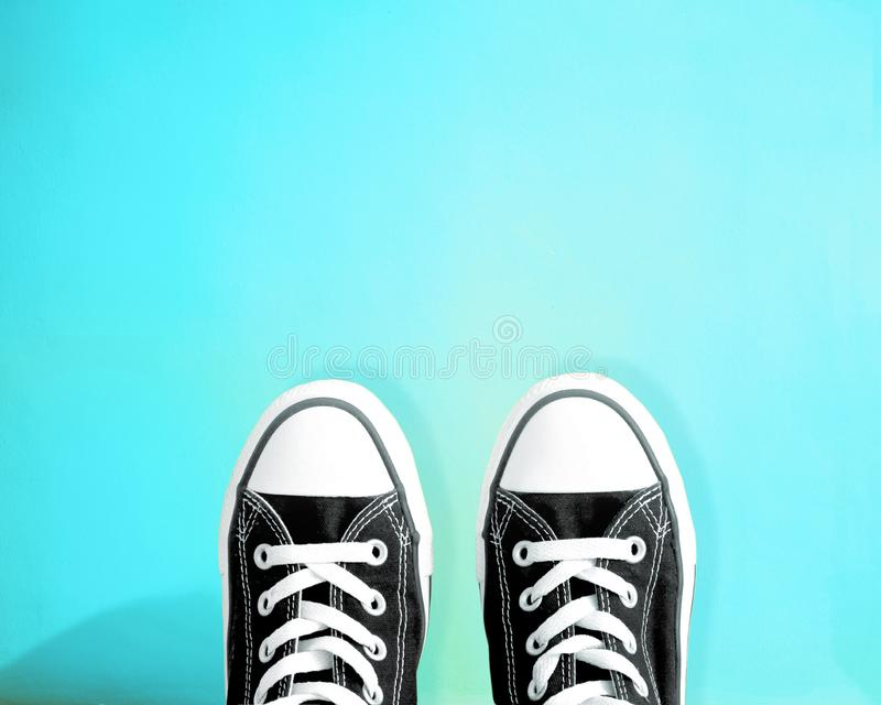 Top view of Converse all star trainers. Top view of Converse all star trainers on blue background stock image