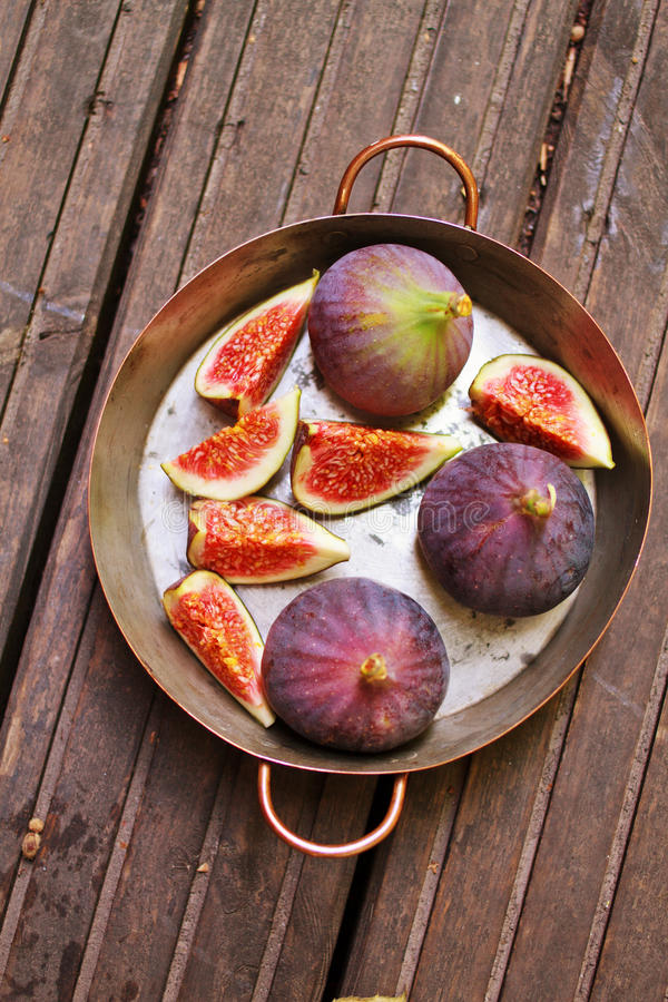 Top view of copper pot with figs. Fresh figs in a copper pot stock photo