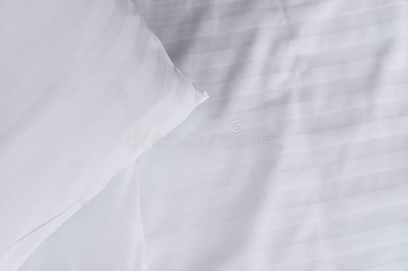 Top view corner of white pillow on white clean bed close up,. Copy space stock photos