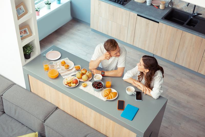 Top view of couple having croissants and coffee in the morning royalty free stock photos
