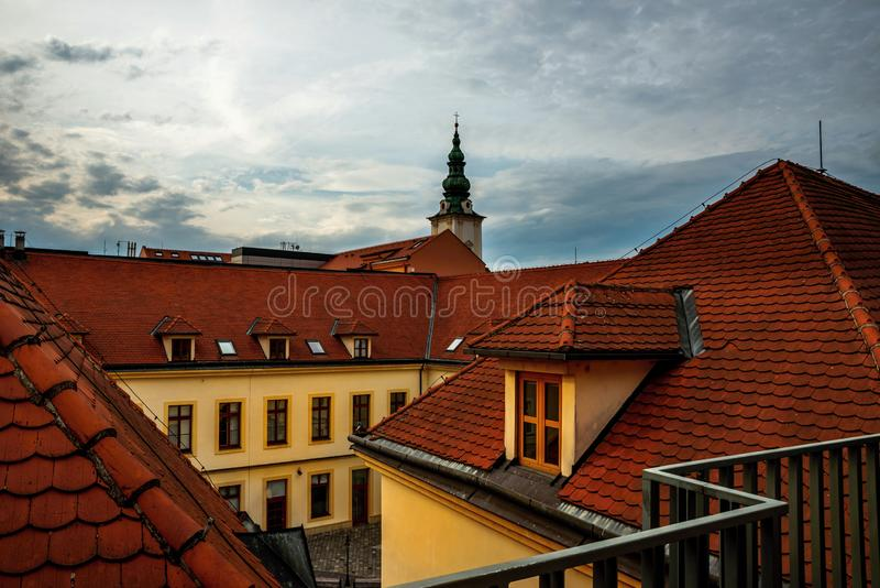 Red roofs, buildings and church in Uherske Hradiste. Top view of courtyard old town hall and red roofs, buildings and church tower Annunciation of the Virgin stock image