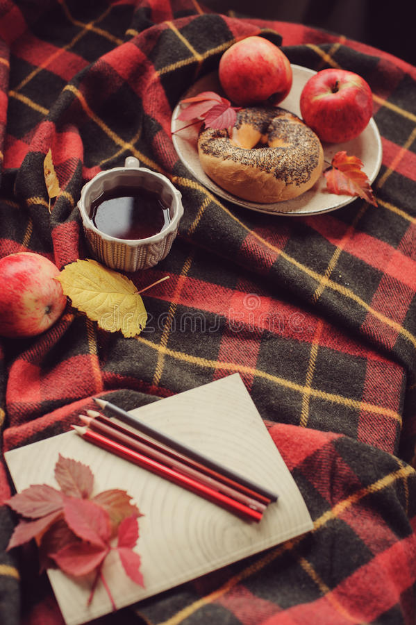 Top view of cozy autumn morning at home. Breakfast with pot of tea and bagel with apples stock photos