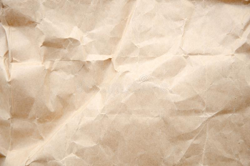 Top view craft paper texture. Crumpled cream paper background royalty free stock images