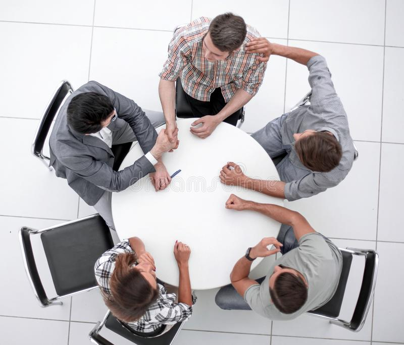 Top view.creative business group sitting at the round table stock image