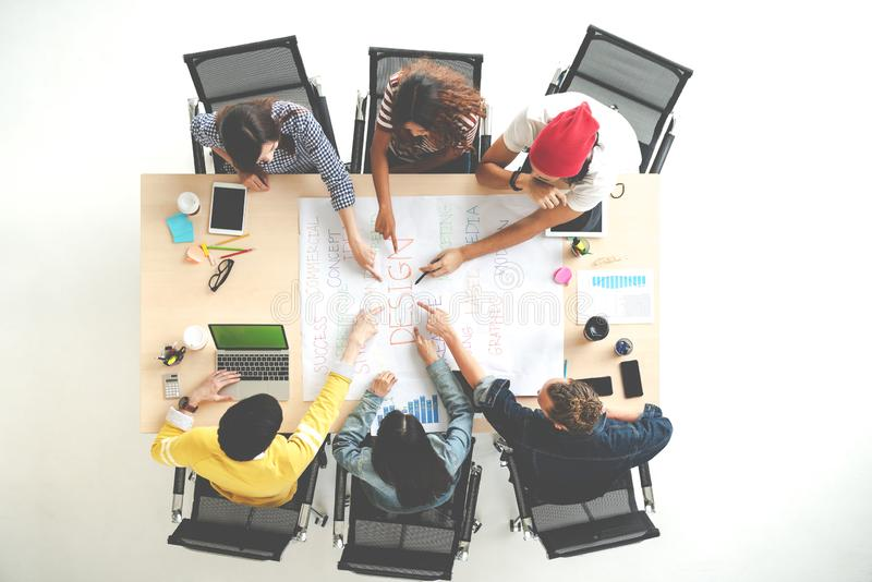 Top view of creative diverse people agree result together. Overhead view of young creative team, start up colleagues group or stock images