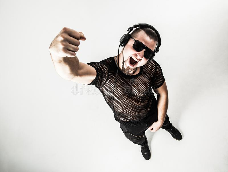 Top view - creative rapper in the headphones and dark glasses pe royalty free stock photos