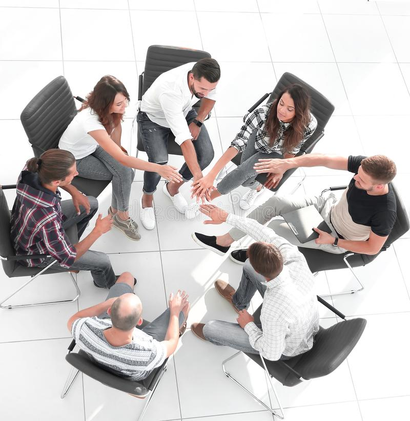 Creative team sitting in class for team building royalty free stock photography