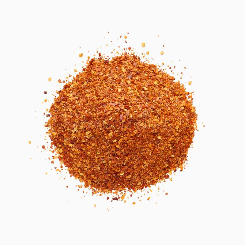 Top view of crushed dry red hot chili pepper heap stock photos