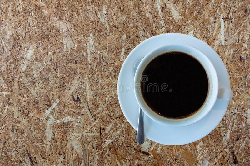 Top view a cup of black coffee on cork board wood background stock photos