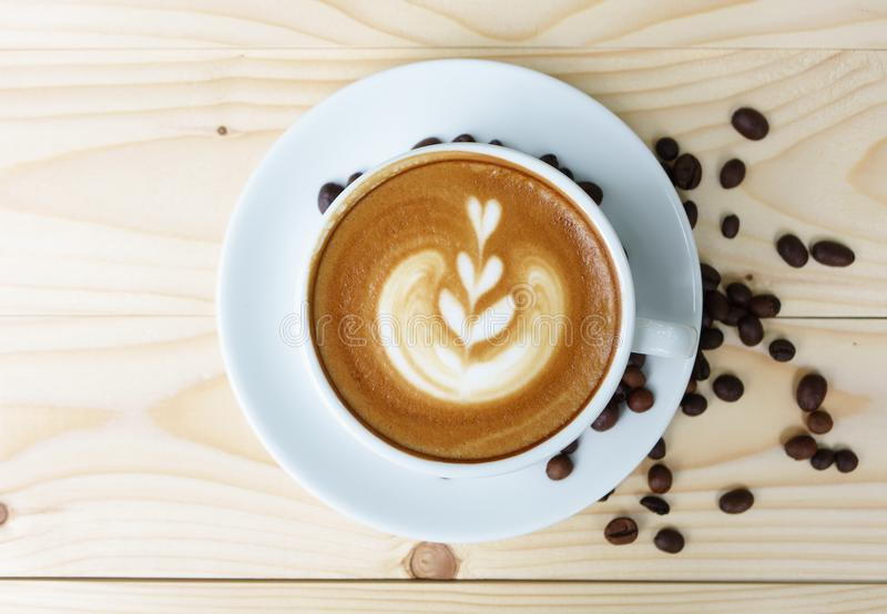 Coffee cup with on wooden table royalty free stock photos