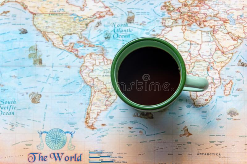 Top view of cup coffee one the word map for Traveler accessories and items man with backpack and visiting for planning travel vaca. Tions.  Travel and Summer stock photo