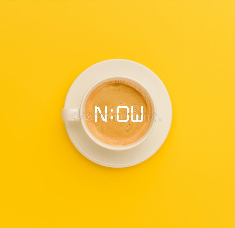 Cup of fresh coffee. Top view of cup of fresh hot coffee isolated on yellow stock photos