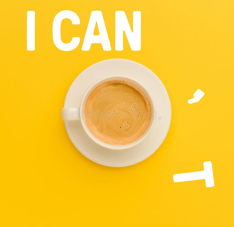 Cup of fresh coffee. Top view of cup of fresh hot coffee isolated on yellow stock image