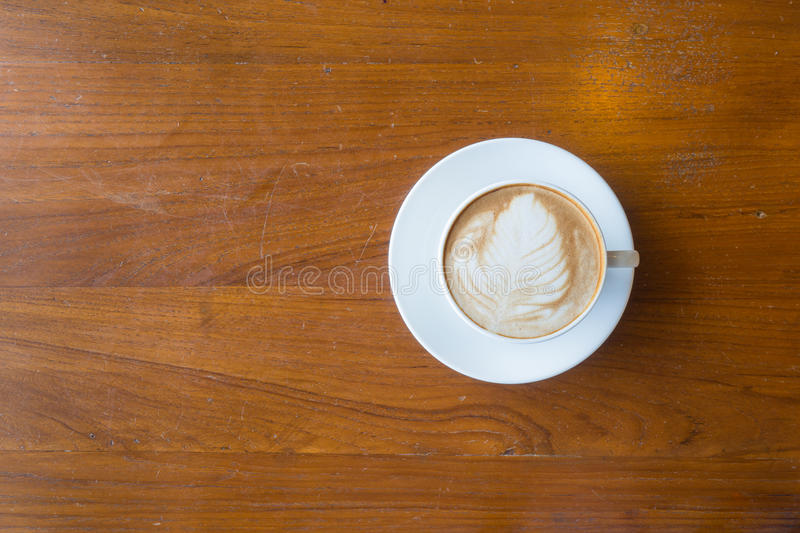 Top view of a cup of hot coffee put on old wooden table background. Copy space stock photography