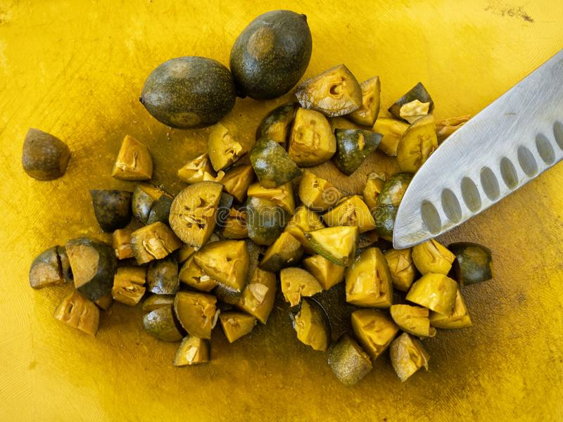 Cut board with chopped unripe walnuts prepared for cooking jam that rich of natural iodine stock image
