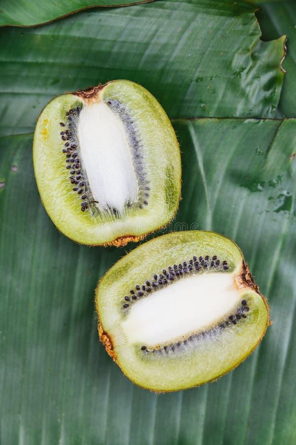 Top view of cut half Thai Kiwi on banana leaves. Example fruity taste of coffee.  royalty free stock image