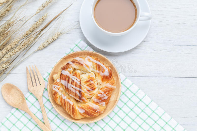 Top view danish pastries and coffee cup on white wooden table royalty free stock photography