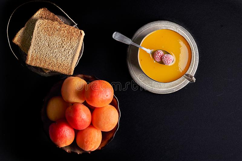 Fresh apricots, homemade apricot jam, toasted bread toast with jam, royalty free stock photo