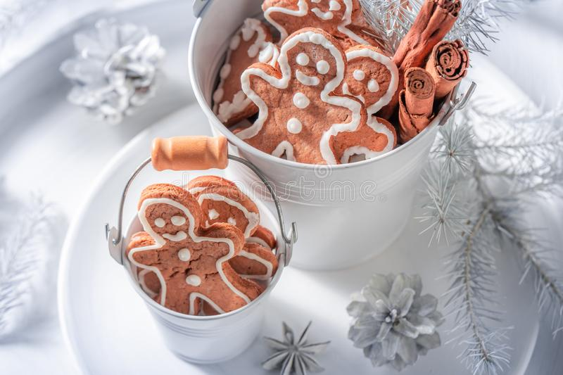Top view of delicious Christmas gingerbread man in small bucket. On white table stock images