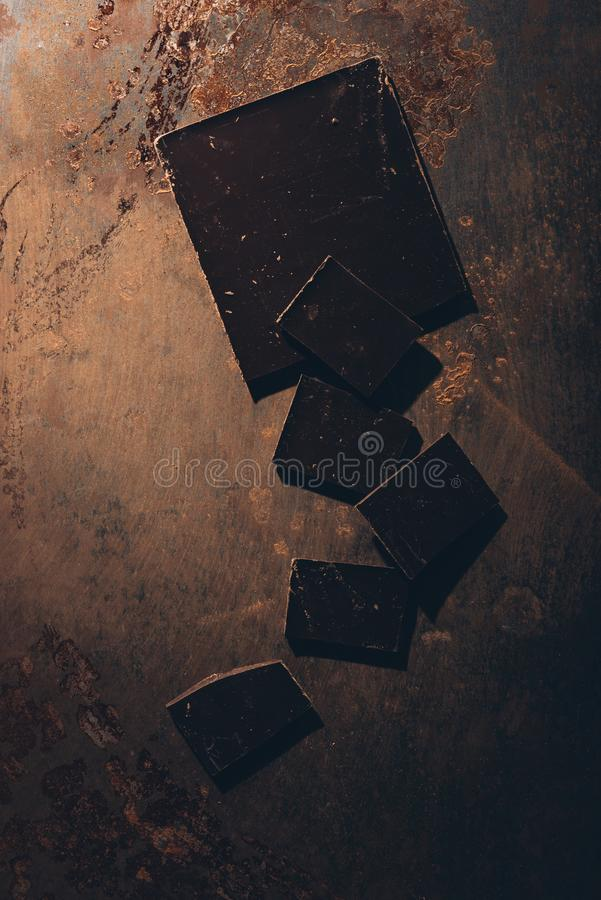 Top view of delicious dark chocolate. On rusted surface stock images
