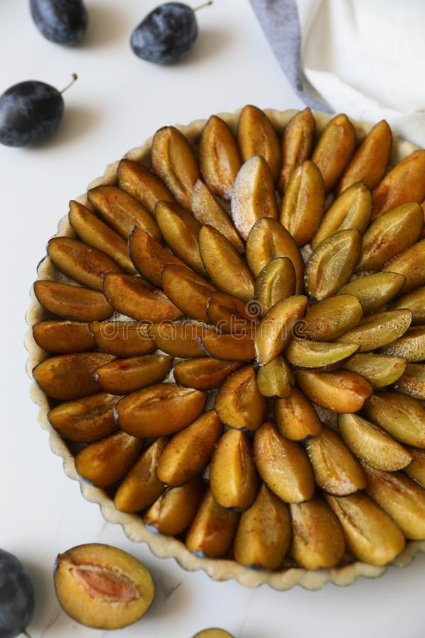 Top view of delicious Traditional Alsatian Plum tart French: Tarte aux quetsches alsacienne stock photos