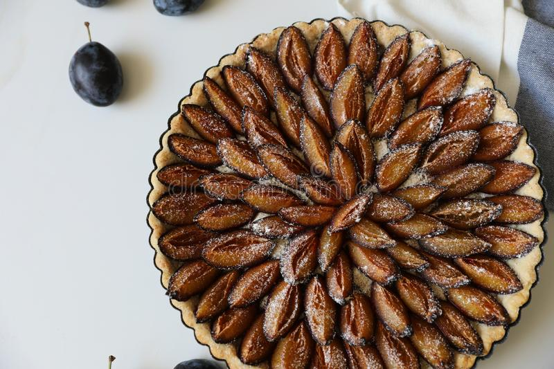 Top view of delicious Traditional Alsatian Plum tart French: Tarte aux quetsches alsacienne stock image
