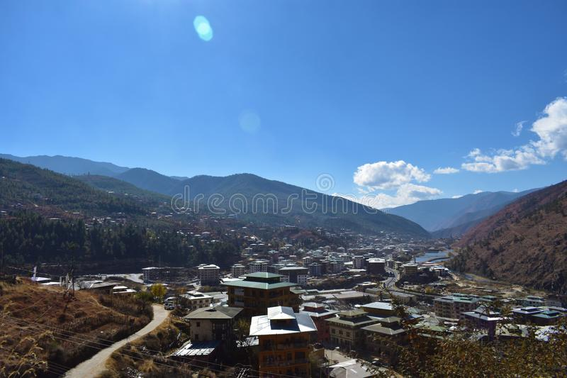 Top view of the densely packed dwellings down the hill in the valley of Thimphu stock image