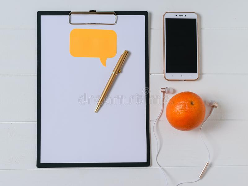 Top view of the designer`s workplace with smartphone, tablet and pen. Work at home stock image