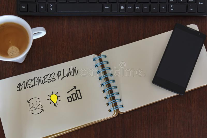 Top view of desk table with notebook with business plan. Teamwork and Successful idea concept.  royalty free stock photos