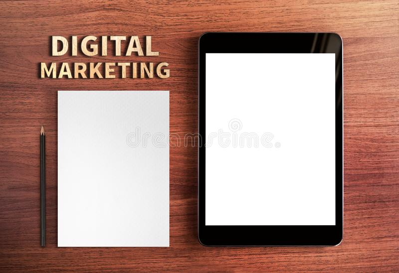 Top view of Digital Marketing word and tablet and pencil,white p royalty free stock photography
