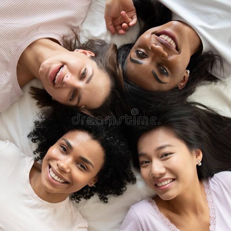 Free Top View Diverse Young Women Friends Lying In Bed Together Royalty Free Stock Image - 174268976