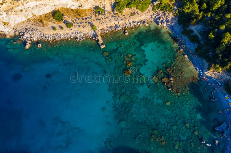 Top view from drone to shore with beach of Anthony Queen Bay, Greece Rhodes, popular tourist destination. stock photography