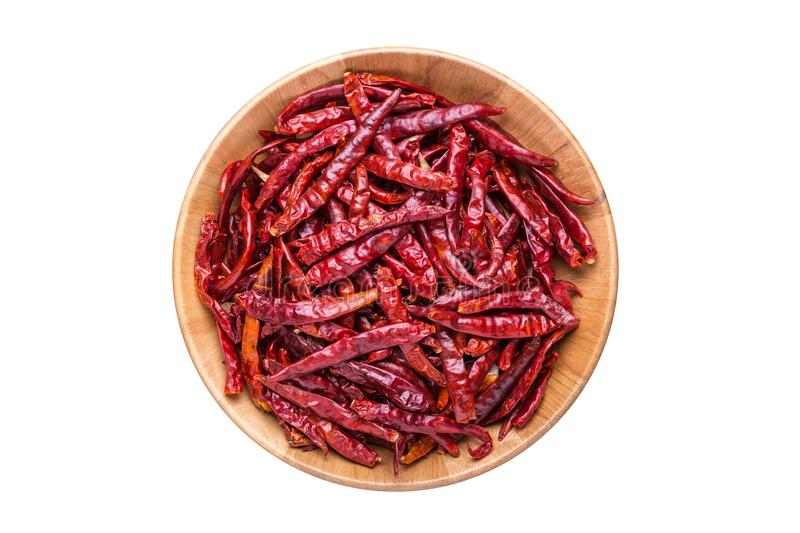 Top view dry red hot chilli in wooden bowl stock photos