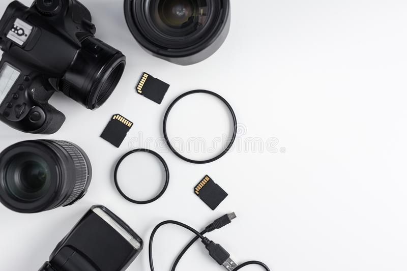 Top view of dslr camera, lenses, photo equipment and copy space stock photography