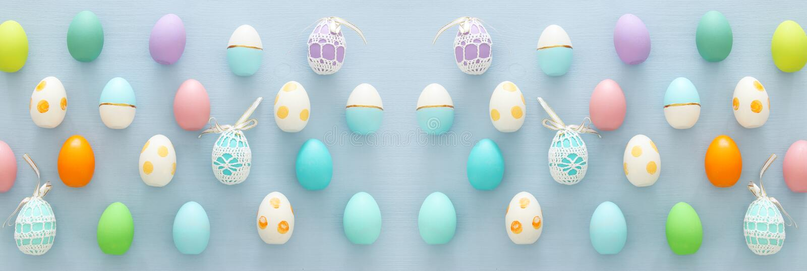 Top view of easter colorful eggs over blue background. Top view of easter colorful eggs over blue background stock image