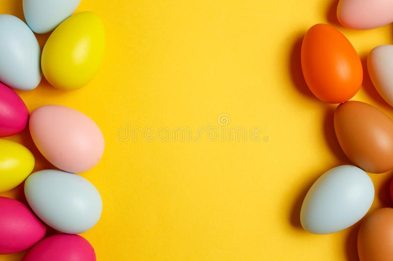 Colorful Easter eggs on a yellow background royalty free stock images