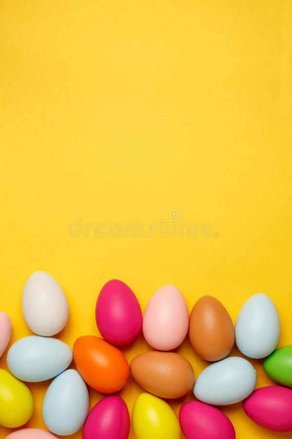 Colorful Easter eggs on a yellow background stock image