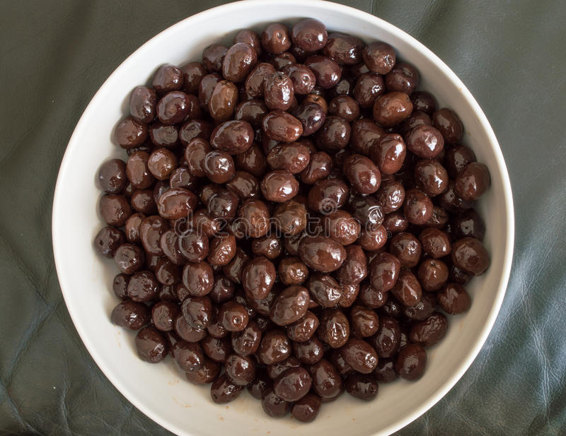 Top view of edible organic black olive. Pile stock image