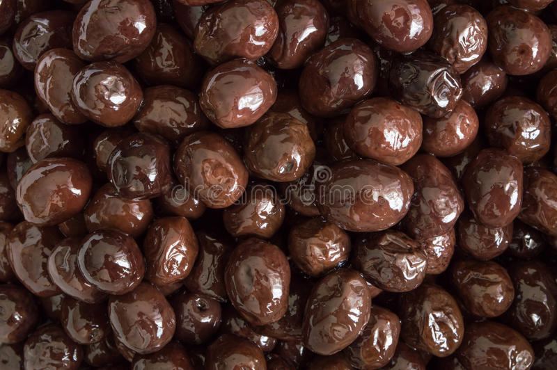 Top view of edible organic black olive. Pile royalty free stock images