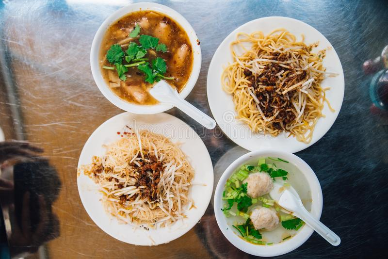 Top view of egg noodles with sprout served with fish in gravy and clear soup with minced pork. Street food in Taipei, Taiwan.  stock photos