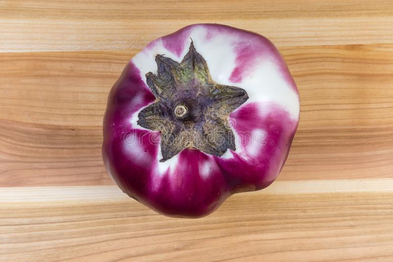 Top view of eggplant Helios on a wooden surface royalty free stock photos