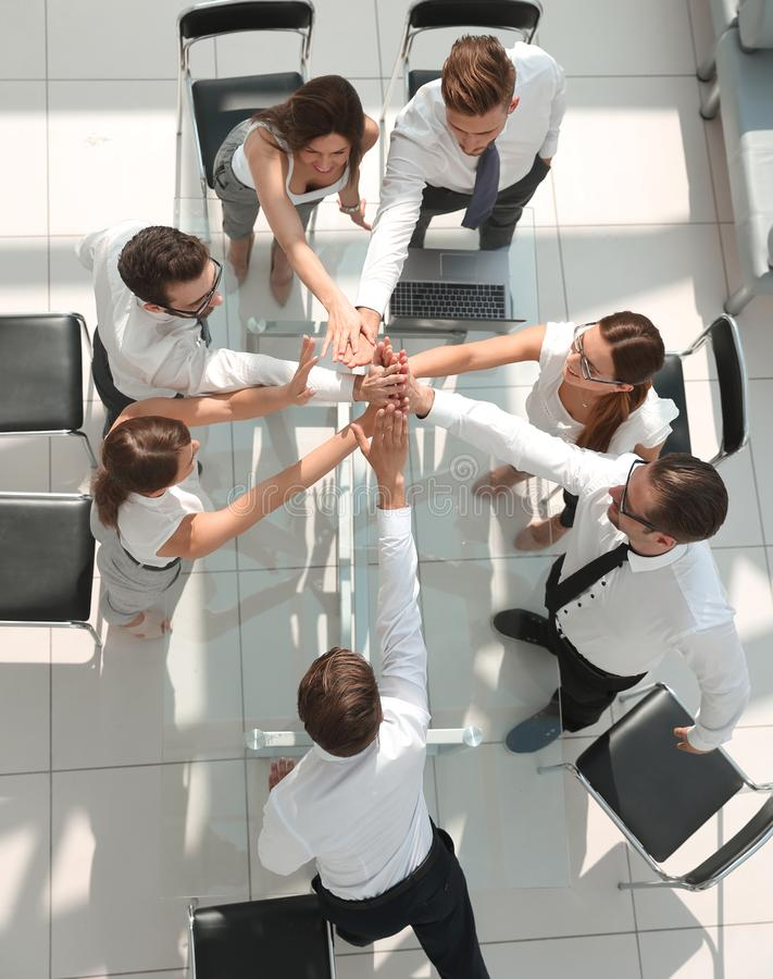 Top view.employees of the company showing their unity stock photos