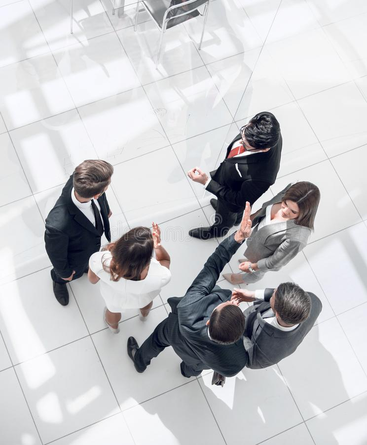Top view. employees discussing work issues royalty free stock image